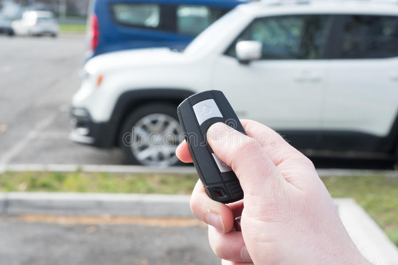 Hand holding one car alarm key with anti-theft. Hand holding a car alarm key anti-theft royalty free stock photography