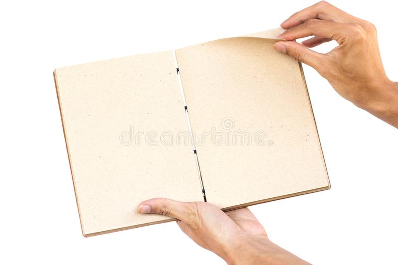 Hand holding open hand made book isolated on white background. Clipping path. stock images