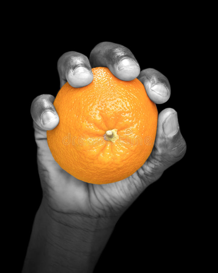 Hand Holding An Orange - Partially Monochrome, Low Key Royalty Free Stock Images