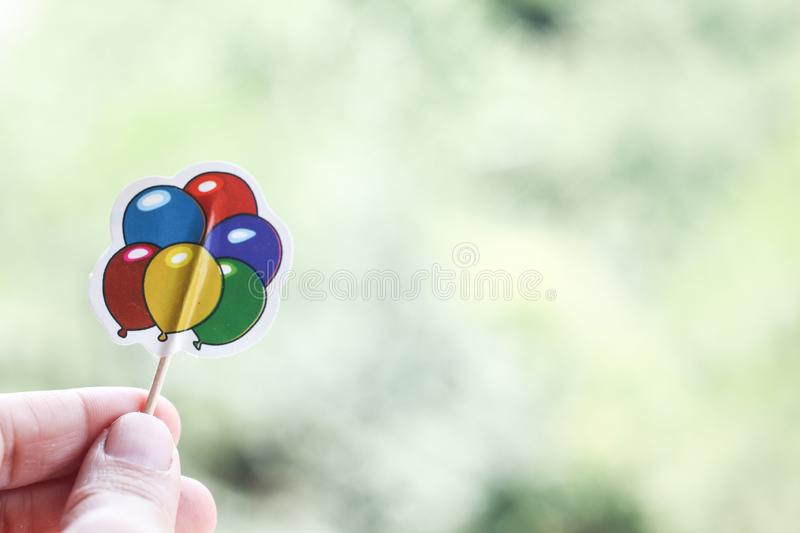 Hand holding paper balloons stock photos
