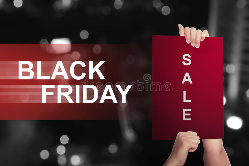 Hand holding paper with sale text on Black Friday stock image
