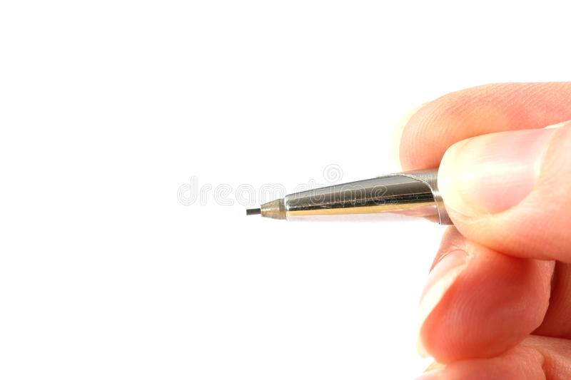 Hand holding a pencil stock photo