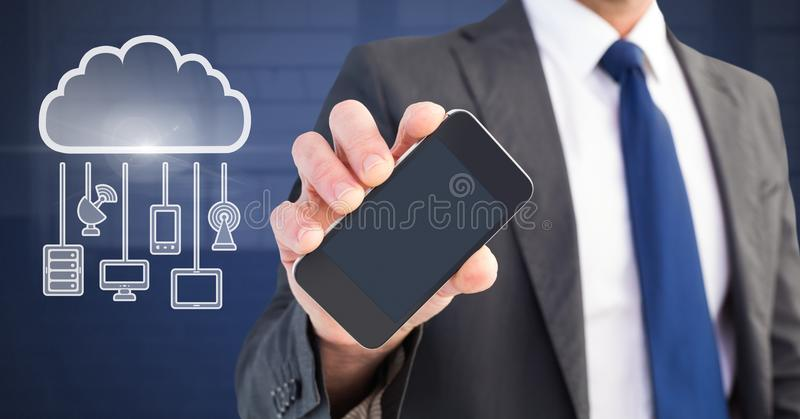 Hand holding phone with cloud icon and hanging connection devices. Digital composite of Hand holding phone with cloud icon and hanging connection devices stock photography