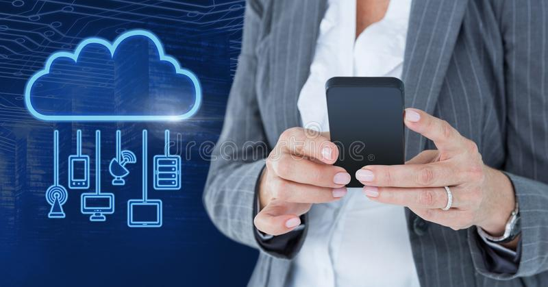 Hand holding phone with cloud icon and hanging connection devices. Digital composite of Hand holding phone with cloud icon and hanging connection devices stock image
