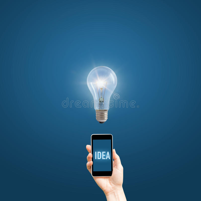 Hand holding a phone with the words idea. royalty free stock photo