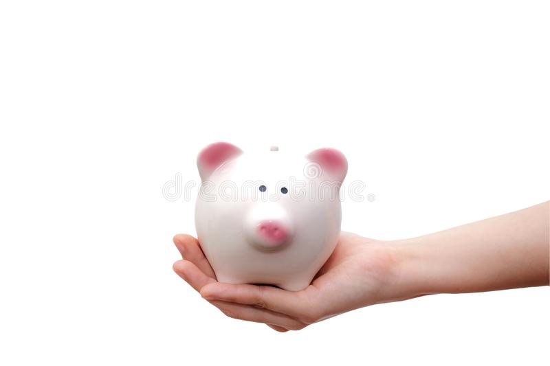 Hand holding piggy bank isolated on white background. Saving concept. royalty free stock images
