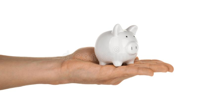 Hand holding piggy bank isolated on white clipping path.  royalty free stock image