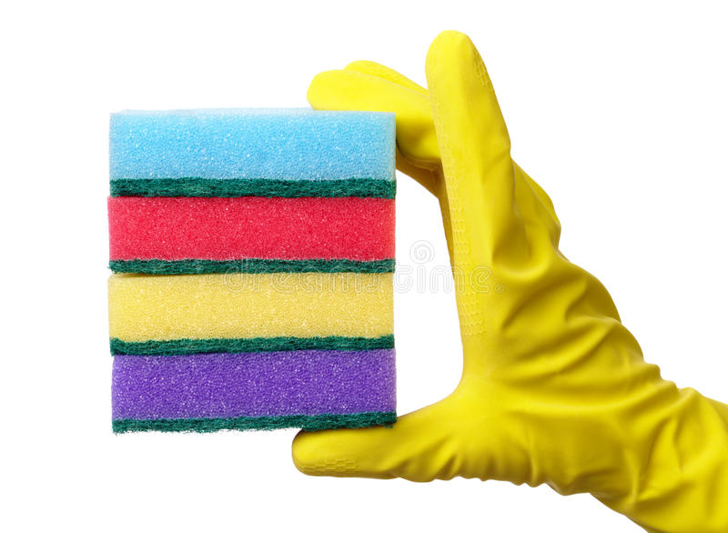 Hand holding a pile of washing sponges stock image