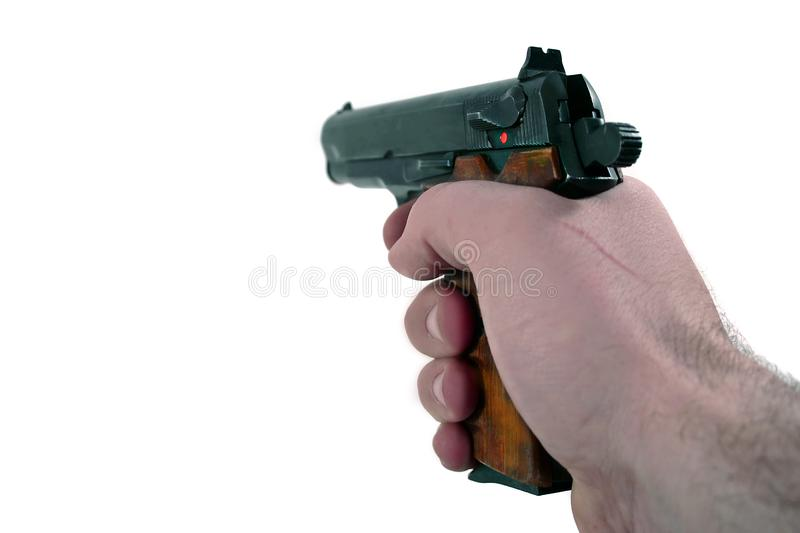 Hand holding a pistol stock images