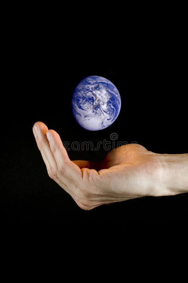 Hand holding planet earth stock photography