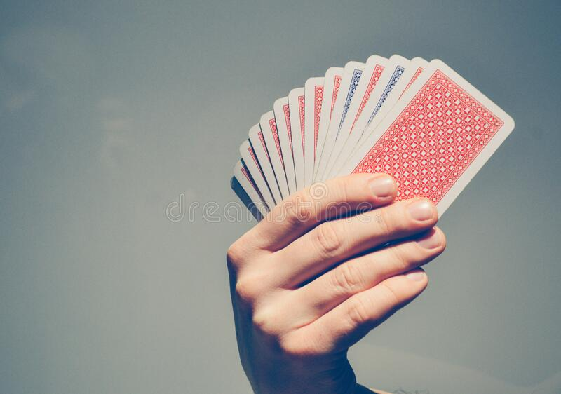 Hand holding playing cards royalty free stock images