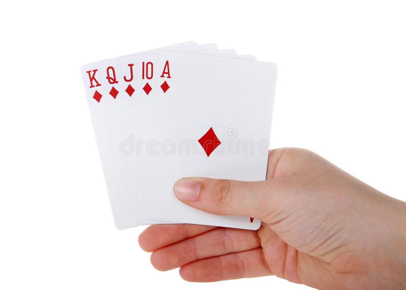 Hand holding Playing cards, royal flush isolated. Young female hand holding Playing cards, royal flush. It is a straight flush that has a high card value of Ace royalty free stock photo