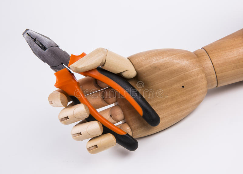 Hand holding a pliers royalty free stock image