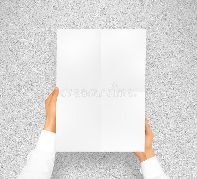 Hand holding poster mock up design mockup. Hand holding poster mock up. Nice mockup to show your design, picture or illustration. Blank sheet in hands near the royalty free stock image