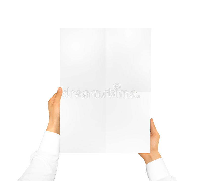 Hand holding poster mock up. Nice mockup to show your design, pi. Cture or illustration. Blank sheet hold in hands isolated on white background. Display movie stock photo