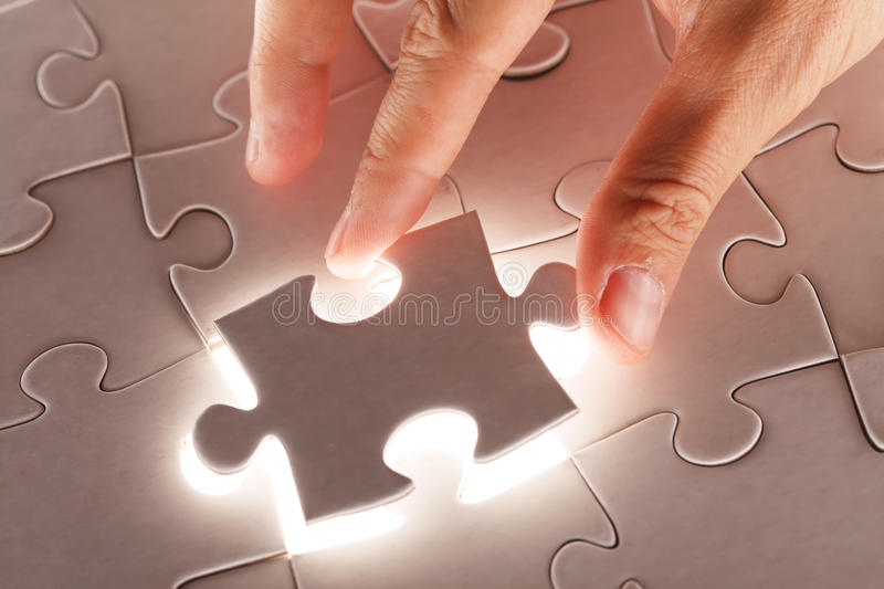 Hand holding puzzle piece royalty free stock photos