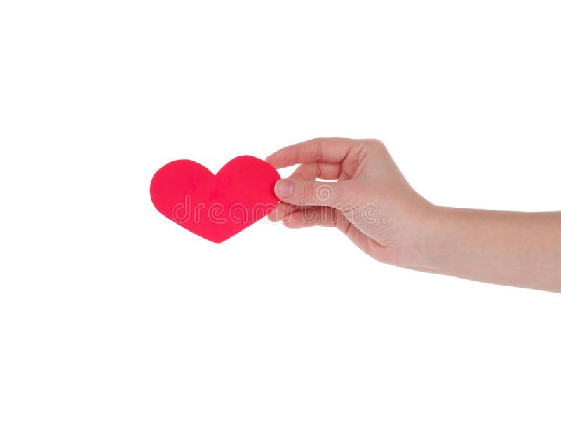 Hand holding a red heart.the concept of love, Valentines day, symbol and romantic. red heart for gift stock photos