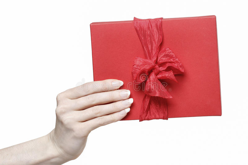 Hand holding red present box stock photos