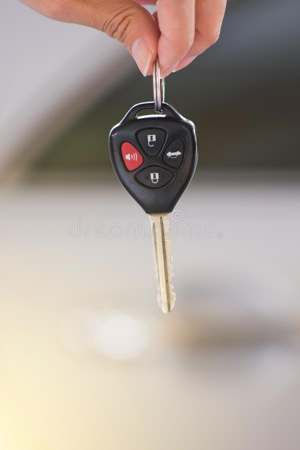 Hand holding remote car key. stock images