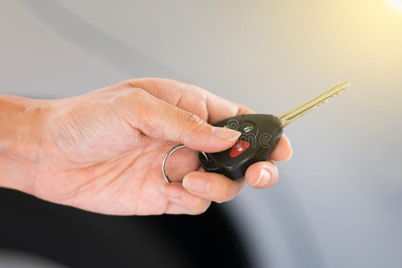 Hand holding remote car key. royalty free stock photos