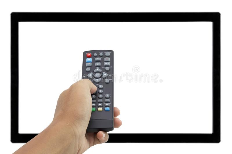 Hand holding remote control at television screen stock image