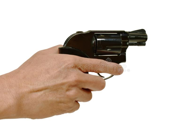 hand holding revolver gun and finger safety on trigger in white background royalty free stock image