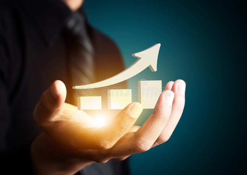 Hand holding a rising arrow,business growth. royalty free stock photo
