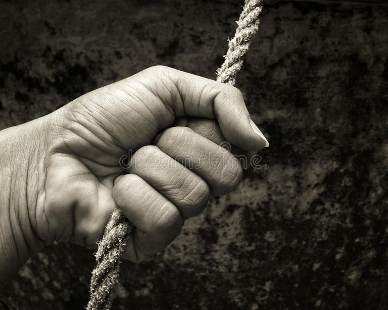 Hand holding a rope royalty free stock photos