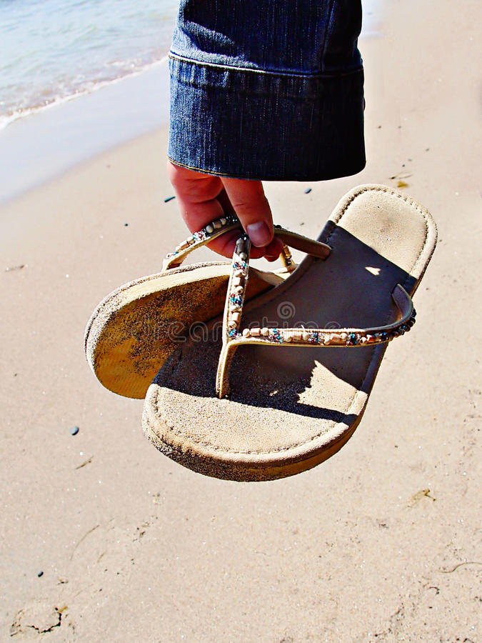 Download Hand Holding Sandals Stock Photos - Image: 10594033