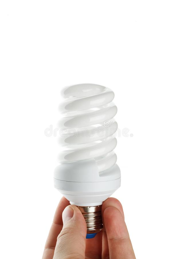 Hand holding saving bulb on a white background. Lamp, electricity, energy, glass, lightbulb, power, technology, bright, design, electrical, illumination royalty free stock photography