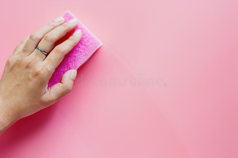 Hand holding scrub sponge and wiping clean royalty free stock photos