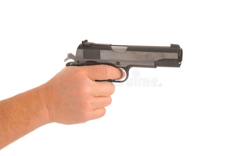Hand Holding Semi-automatic Pistol Royalty Free Stock Image