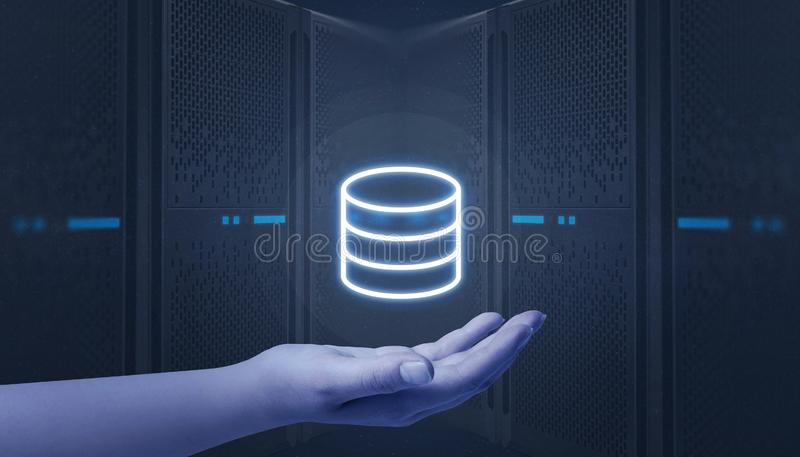 Hand holding server, data center icon. Web hosting servers in background stock photography