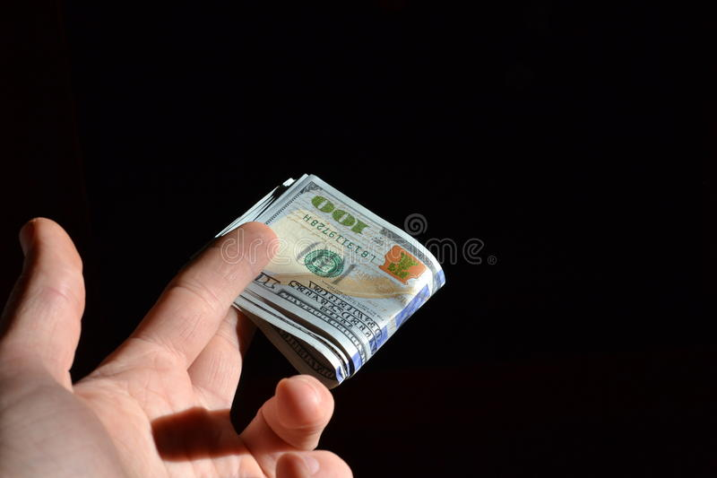 Hand holding several dollar notes royalty free stock photo