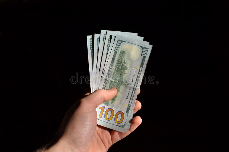Hand holding several dollar notes royalty free stock images
