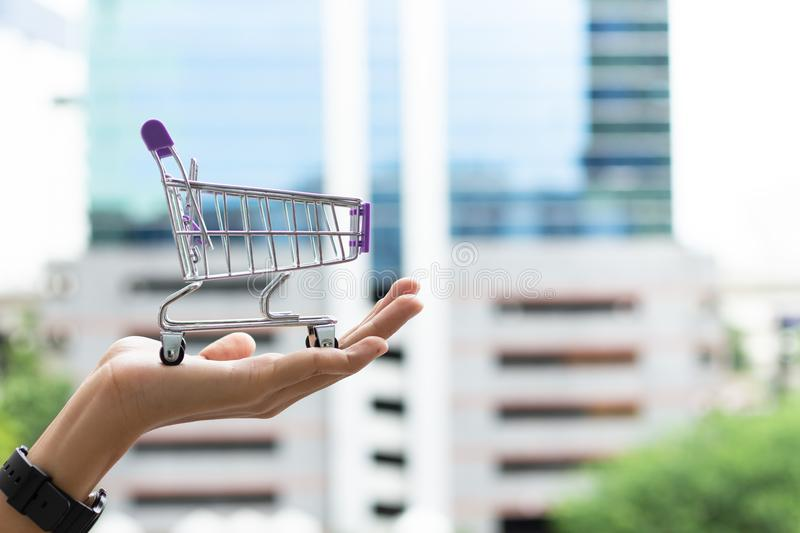 Hand holding shopping cart. Image use for shopping mall, online and offline store, marketing retail concept.  stock photos