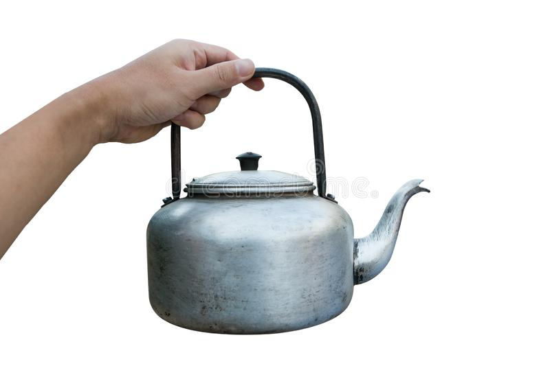 Kettle for camping isolated on white background. Hand holding Small classic kettle for camping isolated on white background stock photo