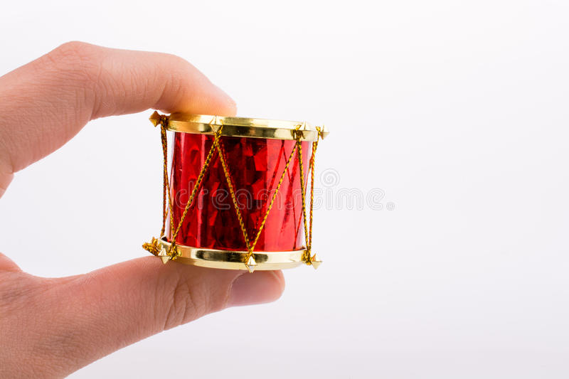 Hand holding a small drum. On a white background stock photography