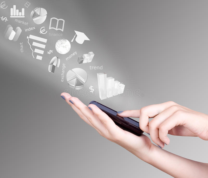 Hand holding smart mobile phone and exchange symbols flying away royalty free stock photo