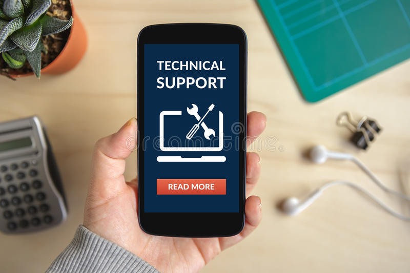 Hand holding smart phone with technical support concept on scree stock photos