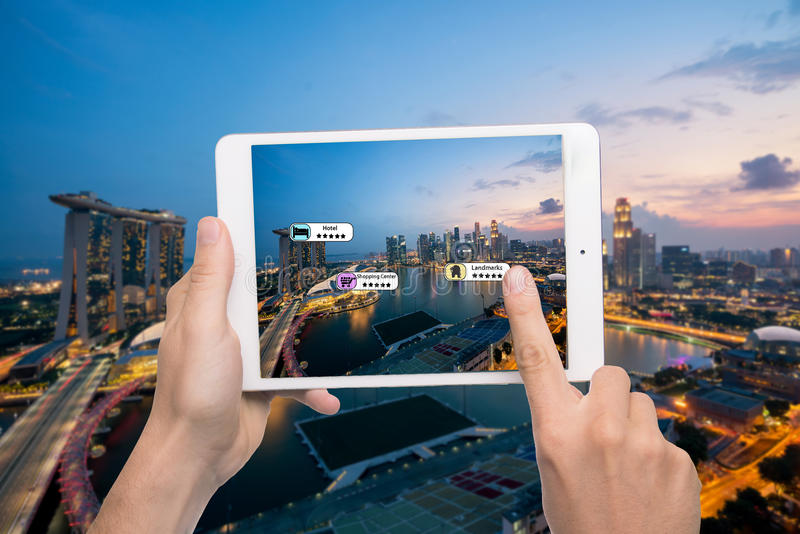 Hand holding smart phone use AR application to check relevant in. Formation about the spaces around customer. Singapore City in background. Augmented reality royalty free stock images