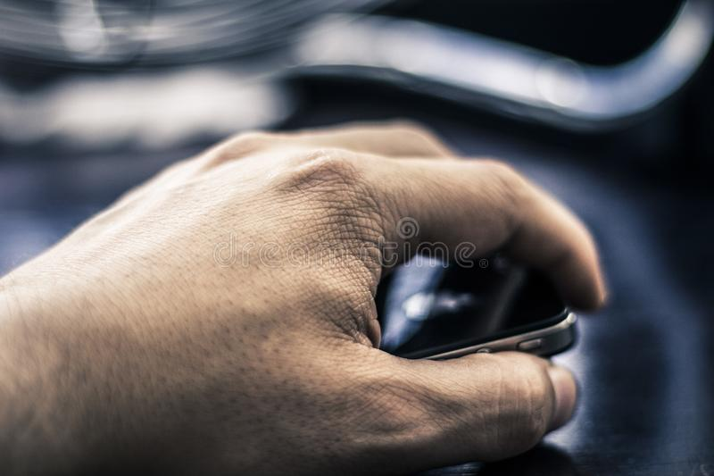 Hand holding smartphone stock image