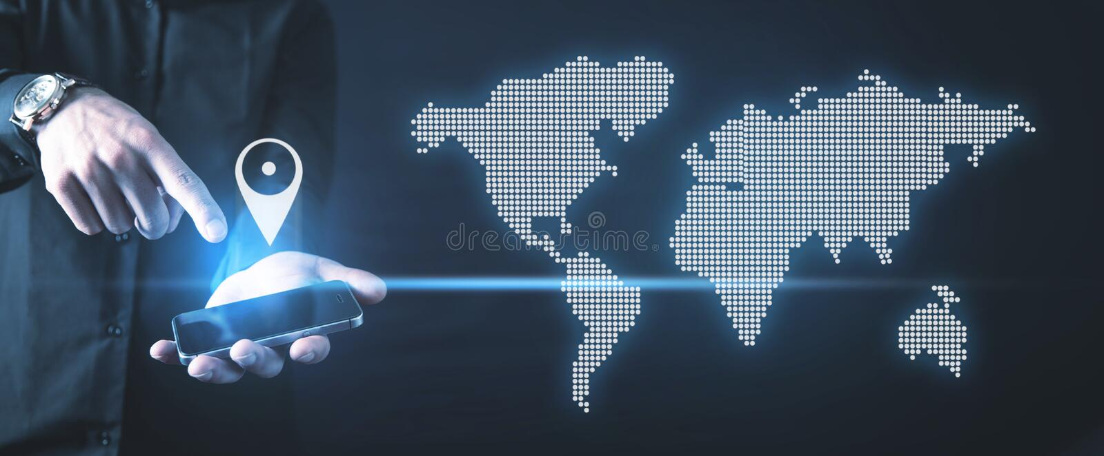 Hand holding smartphone. Gps concept with a world map royalty free stock photography