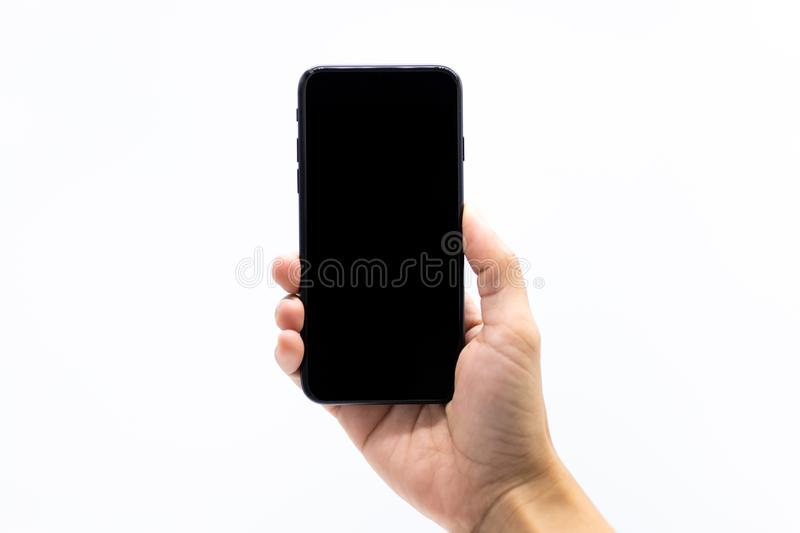 Hand holding smartphone, image use for mobile applications and multimedia programs.  royalty free stock photos