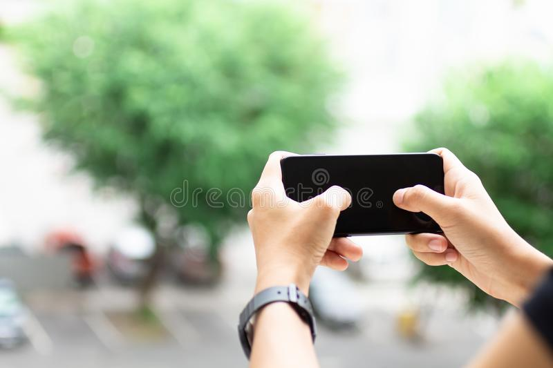 Hand holding smartphone, image use for mobile applications and multimedia programs.  royalty free stock photography