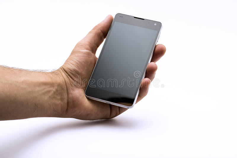 Hand holding smartphone / phone (isolated). Mens hand holding and showing modern mobile smartphone with blank screen. Isolated on white background