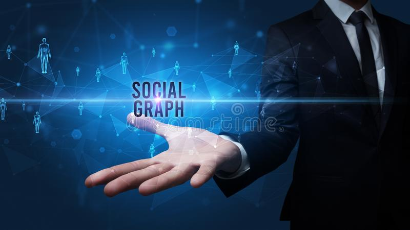 Hand holding social media related inscription. Elegant hand holding SOCIAL GRAPH inscription, social networking concept stock images