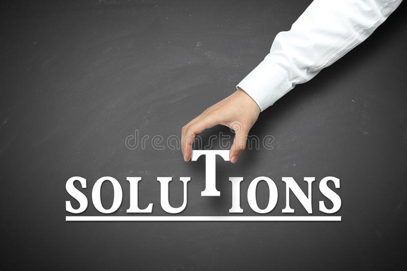 Hand holding solution concept stock photography