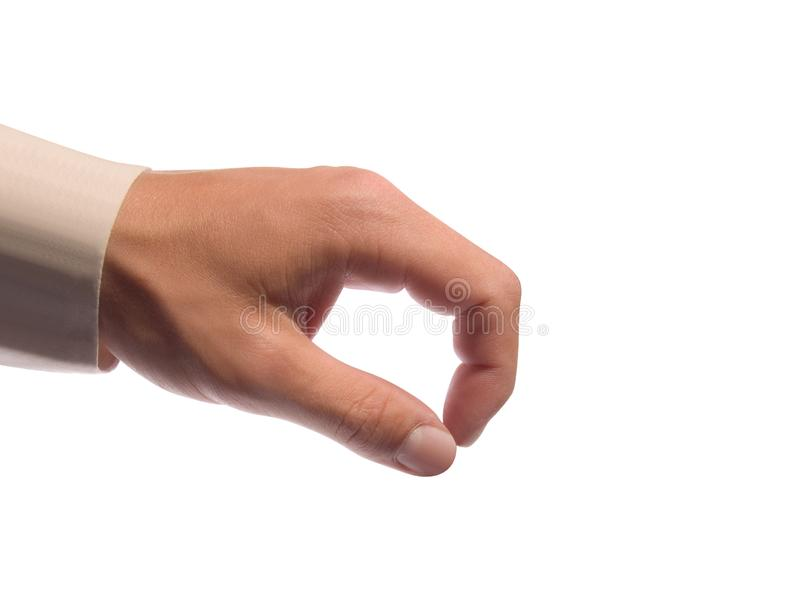 Hand holding some tiny or thin object royalty free stock photography