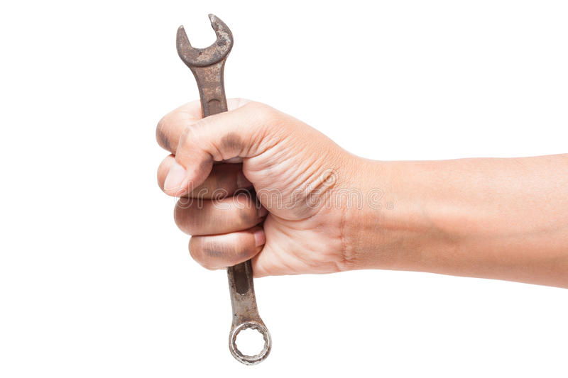 Hand holding a spanner. Isolated on a white background with using path royalty free stock images